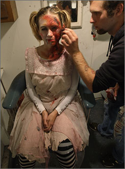 Make-up artist Eric Mauer prepares Sarah Baker for the part of Anna, the captain's daughter, on the USS Nightmare.