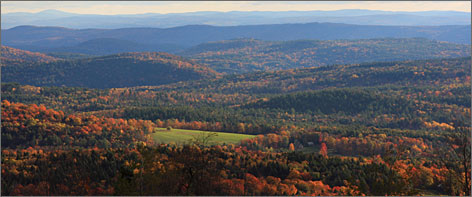 If New England is synonymous with fall foliage, then Vermont's Route 100, with views of autumnal colors covering rolling hillsides, is the reason.