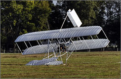 A replica of the Wright Flyer after it crashed in a field in Dayton, Ohio on Thursday. Pilot Mark Dusenberry had planned to fly the craft during a celebration on Monday marking the 104th anniversary of the Wright brothers first flight.