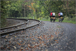 Woodsy: The GAP bike path climbs out of Cumberland, Md., parallel with the rails of the Western Maryland Scenic Railway.