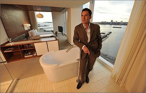 Not your standard hotel: Andre Balazs shows off a river-view Hudson Suite with in-room tub at his new hotel, The Standard, New York.