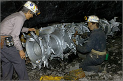 Animatronic miners work on a drill in Portal 31, a tourist mine in Lynch, Ky.