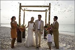 At Sandals and Beaches: Bridal couples can get a complimentary Martha Stewart wedding.