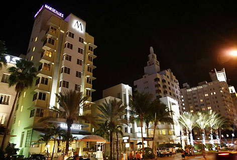 Night moves: Miami Beach's Collins Avenue is a paradise of bright lights and people-watching.