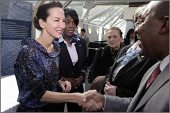 Good look: Cynthia Rowley, left, who will be designing new uniforms for United Airlines, gets input from flight attendants.