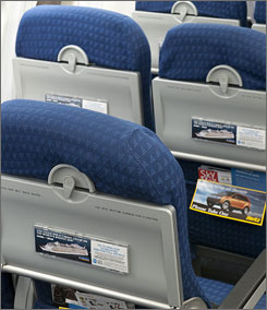 AirTran will outfit its entire fleet with seatback advertising.
