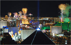 Fireworks explode from the rooftops of Las Vegas hotels in this Jan. 1, 2008, photo. Audiences were disappointed by last year's ground-based displays.
