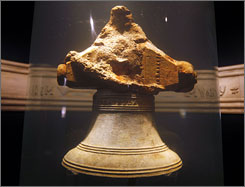 Artifacts on display from the Whydah include treasure chests, cannons, swords and a bell inscribed with the ship's name.