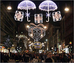 Shoppers enjoy the holiday displays on Oxford Street in London. Virgin Vacations is offering six-night London packages starting at $769 per person.