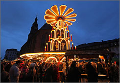Visitors gather around a lighted display at the Heidelberg Christmas market.