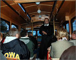 In Wisconsin: Door County Trolley driver Bob Kohout points out the scenes of unsolved mysteries aboard the Trolley of the Doomed.