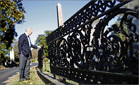 David Gilliam, general manager of Hollywood Cemetery in Richmond, Va.,  points out fencing that needs to be restored.