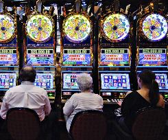Patrons play slot machines at the Sands Casino Resort Bethlehem. Pennsylvania has just legalized poker and other table games at slots parlors.