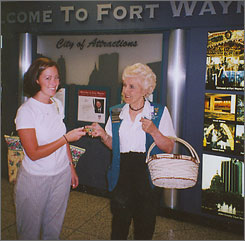 Volunteer Mary Gebhard hands out free cookies at Fort Wayne International Airport.