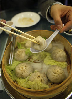 Dumplings filled with broth and ground pork are the signature dish at Joe's Shanghai restaurant.