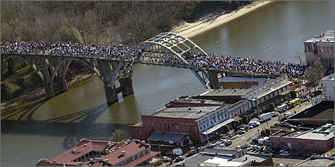 In Selma, Ala.: The Selma-to-Montgomery march is re-enacted on the Edmund Pettus Bridge.