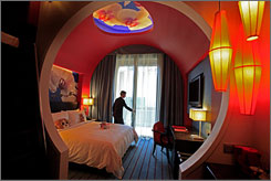 An employee shows off a room at the Hard Rock hotel at Singapore's first casino-resort, Resorts World Sentosa.