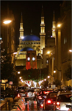 Place de l'Etoile: On a rainy winter's night, the landmark Mohammad al-Amin mosque looms over the parliament's clock tower in the heart of the capital.