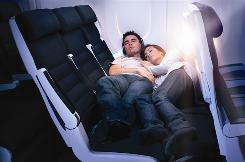 Now a staple in business and first class, Air New Zealand will be installing new seats that will let coach passengers lie flat. The individual seats are like recliners, but when all three seats are reclined with the footrests up, they form a flat surface that two adults can sleep on.