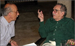 "Gabriel Garcia Marquez, right, speaks with fellow writer Conrado Zuluaga during the 2006 Hay Festival in Cartagena, Colombia. ""He was as perfect a host as you could imagine,"" said festival founder Peter Florence."