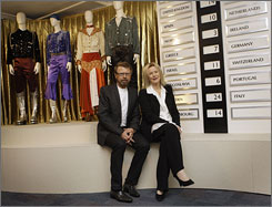 "Former ABBA members Bjorn Ulvaeus and Anni-Frid ""Frida"" Lyngstad pose with their outfits from the 1974 Eurovision performance of ""Waterloo."""