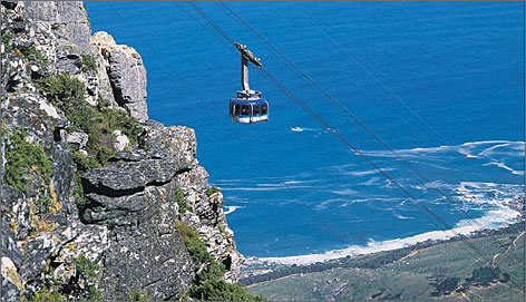 Breathtaking views: A cable car heads up Cape Town's Table Mountain.
