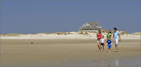Sleepy beach towns: A family enjoys the isolation near Corolla, a northern town in Currituck County. The Outer Banks have limited development and no high-rises.