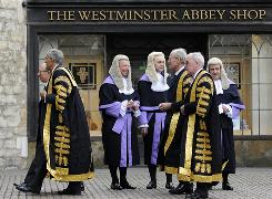 Wigs and tourists: Lords of the U.K. Supreme Court arrive for a worship service at the tourist-friendly Westminster Abbey in London.