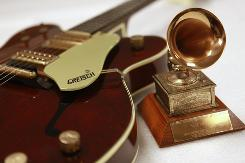 Objects on display include Elvis' first Grammy Award for How Great Thou Art in 1968.