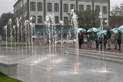Savannah city officials and others gather near the fountain in Ellis Square after the opening ceremony.