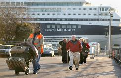 Passengers disembark the cruise ship Celebrity Mercury at the passenger terminal in Charleston S.C. The Mercury's latest cruise was cut short after hundreds of passengers were hit with a stomach illness.