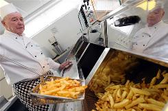 Aspiring owners of fish and chips shops can learn the tricks of the trade at the National Federation of Fish Friers headquarters in Leeds, England.