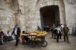 A Palestinian boy sells pastries outside the newly renovated Jaffa Gate in Jerusalem's Old City.