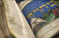 A Hebrew manuscript with illuminations made by master Italian artists from the late 1400s  is presented to the media at the Israel Museum in Jerusalem.