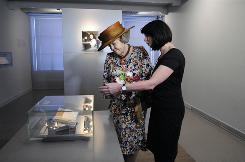 Queen Beatrix, left, views Anne Frank's diary at the Anne Frank House in Amsterdam.