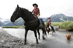 Seward, Alaska: Bree Bardarson, left, owner of Bardy's Trail Rides, leads Equitrekking's Darley Newman around the harbor town, where riders can see wildlife such as bald eagles, mountains and even a beach.