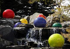 The Dale Chihuly exhibit at Frederick Meijer Gardens and Sculpture Park in Grand Rapids, Mich., features chandeliers, glass towers and floating spheres.