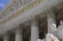 """The Supreme Court is closing its front entrance beneath the words """"Equal Justice Under Law."""" Visitors will instead be directed to a central screening facility to the side of and beneath the central steps."""