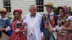Who's ready to whitewash a picket fence? Mark Twain impersonator Richard Garey with two sets of Tom Sawyers and Becky Thatchers in Hannibal, Mo., to mark the 100th anniversary of the author's death on April 21. This year also marks the 175th anniversary of his birth (Nov. 30).