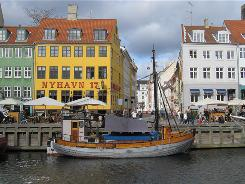 Waterfront dining: The revived port area of Nyhavn is now a tourist magnet, with sidewalk cafes that line the canal.