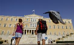 Tourists visit the Unknown Soldier's Tomb in front of the Greek Parliament in central Athens. Tourism accounts for an estimated 17% of annual economic output and one in five jobs.