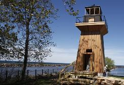 A 1916 storm destroyed the original Point Breeze lighthouse on Lake Ontario. New York officials hope a newly reconstructed replica will draw tourists upstate.