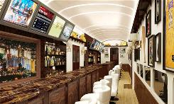 This artist's rendering shows the bar car on the DesertXpress train that would take tourists from Victorville, Calif., to the Las Vegas Strip.