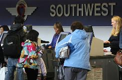 Southwes Airlines requires &quot;passengers of size&quot; to purchase a second seat.