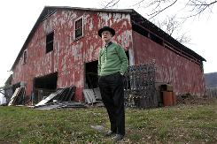 In this Dec. 18, 2007, photo, Hack Ayers visits the barn in LaFollette, Tenn., where his moonshiner father, John Ayers, was killed by state police.