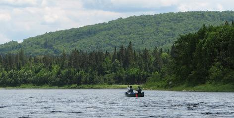 Solitude in paradise: The Upper St. John River in Maine was once a well-traveled wilderness highway, but now it's largely empty, offering these visitors a breathtaking view.