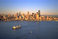 Earth, water, sky: Ferries are a popular form of transportation in Seattle, which is surrounded by water and the Cascade Mountains in the distance.