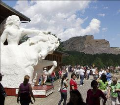 The Crazy Horse Memorial has been under construction since 1948. A museum and film at the site help visitors understand what the memorial is designed to achieve.