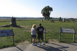 Tourists read about Pickett's Charge at Gettysburg National Military Park in Pennsylvania. Some preservationists worry that a casino would ruin the area's wholesome reputation.