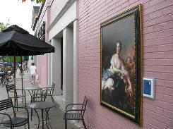 "A reproduction of Jean Marc Nattier's ""The Marquise de Vintimille as Aurora"" hangs outside a Borders bookstore in Grosse Pointe, Mich."
